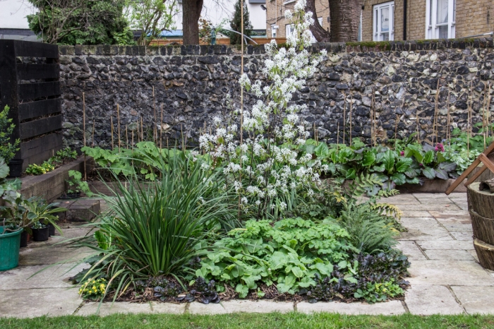The flint wall & the patio bed